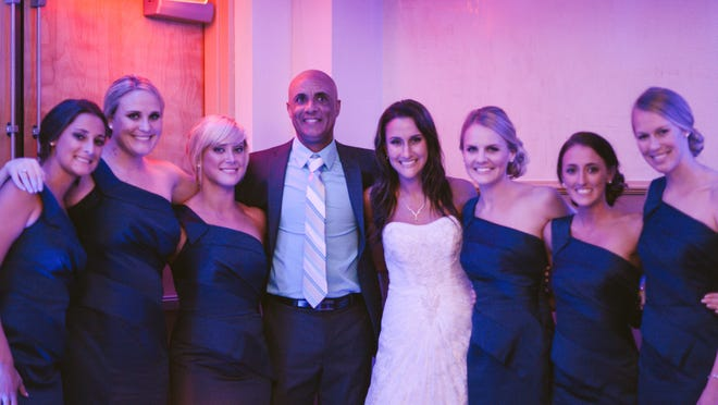 Fidgi Haig enjoys the wedding of his former player, Teresa Brantley Moon, while surrounded by her bridesmaids, all former players under Haig. All will be a part of the memorial game in Haig's honor Saturday at Florida Tech. From left, Katie Jackson, Sara Lewis, DeeDee Newland, Haig, Moon, Megan Stone, KC Correllus and Ella Stephan.