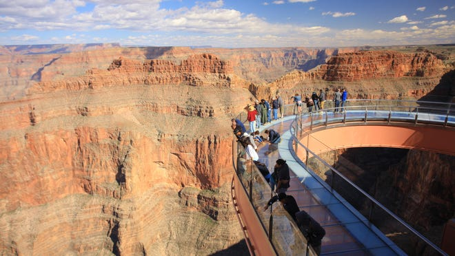 The Grand Canyon Skywalk suspends guests 4,000 feet above the riverbed, cantilevered 70 feet from the canyon walls.