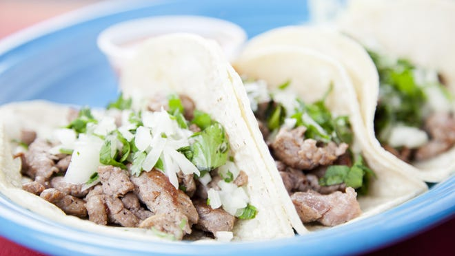 Mexican food: three gourmet steak tacos garnished with onions and cilantro. You might also be interested in these: