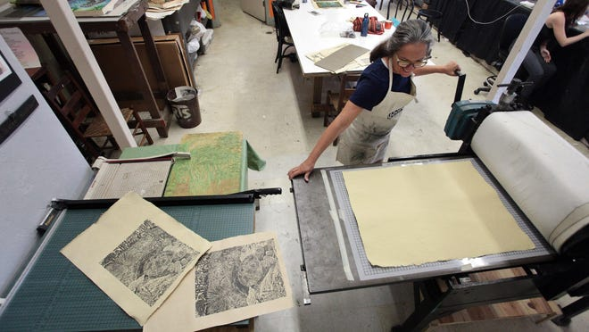 Artist/print maker Leslie Peebles is shown at the Sweetwater Print Cooperative in 2015. The co-op currently has a window show by member artist Joon Thomas.
