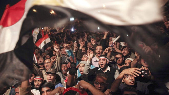 "Egyptians crowd downtown Cairo in February 2011 to celebrate the resignation of President Hosni Mubarak. Author Richard Haass reflects on the lasting legacy of the ""Arab Spring"" pro-democracy uprisings, along with other global trends and events, in his new book, ""The World: A Brief Introduction."""