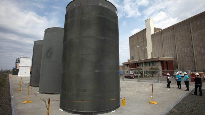 Dry casks holding spent fuel assemblies are shown outside Pilgrim Nuclear Power Station before its May 2019 shutdown. Owner Holtec International has reached an agreement with the state to ensure safe decommissioning of the plant and cleanup of the site.
