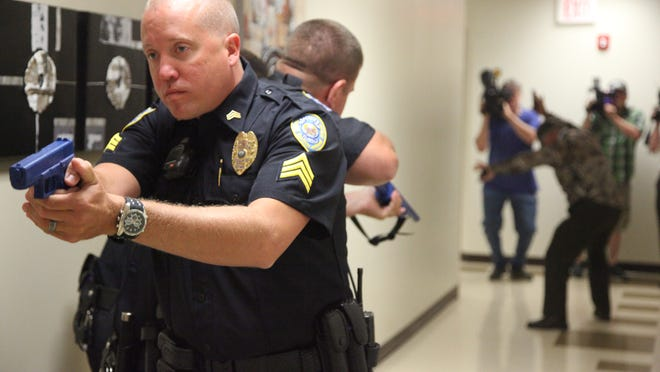 Waukee police take down an actor playing a shooter during an active-shooter demonstration in 2014 at the city's public works building.