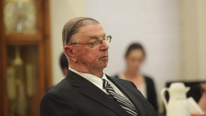 Henry Rayhons listens Thursday as his lawyer makes an opening statement in Rayhons' sexual abuse trial in Hancock County District Court.