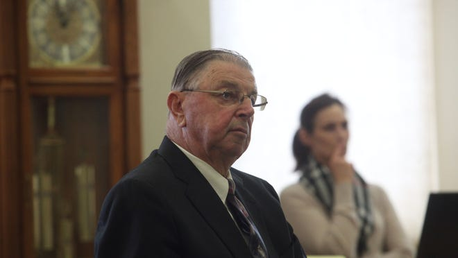 Henry Rayhons listens to testimony Friday in Hancock County District Court.