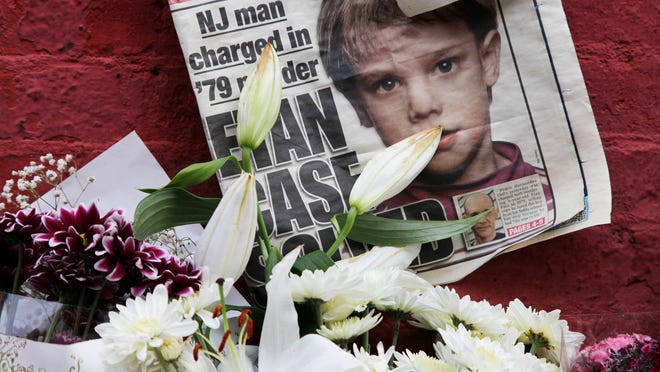 FILE - This May 28, 2012, file photo shows a newspaper with a photograph of Etan Patz that is part of a makeshift memorial in the SoHo neighborhood of New York. (AP Photo/Mark Lennihan, File)