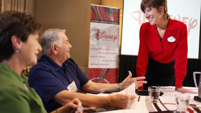 A Disney Institute facilitator talks during a seminar.