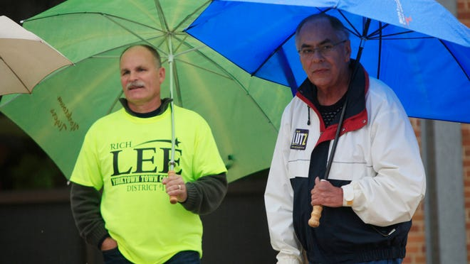 Jack Lutz talks to constituents outside the polling center located at Yorktown Middle School. Lutz is trying to gain enough votes to take keep his seat as the House District 35 representative.