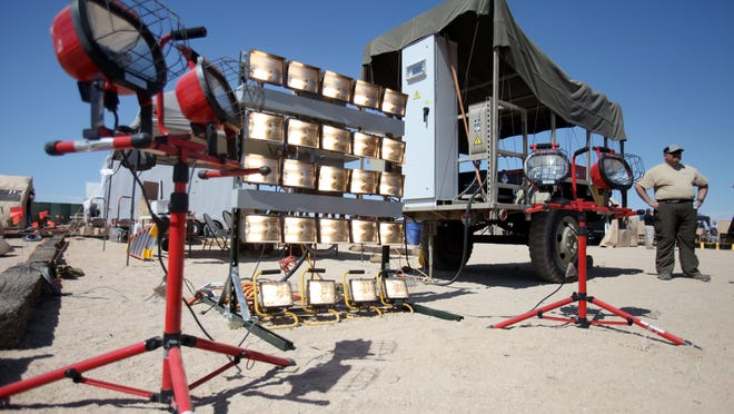 Lights are lit up by a battery system on display by EnerDel during ExFOB (Experimental Forward Operating Base) at the Marine Corps Air Ground Combat Center on Thursday, May 9, 2013, in Twentynine Palms, Calif.