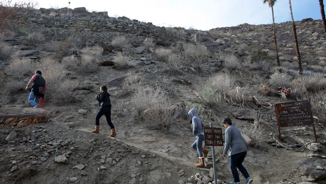 The Skyline Trail, being accessed by hikers in December, is one of several trails that could change hands in a land swap between the BLM and the Agua Caliente tribe.