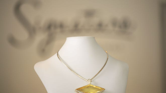 This geometic-shaped 140-karat yellow citrine and white sapphire necklace by Signature is a showstopper.