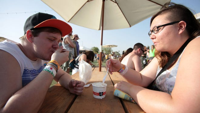Bryson Drake and Sarah Matsui Von Guetzow enjoy seasalt with carmel ribbon ice-cream by Salt & Straw at the Coachella Music and Arts Festival on Saturday, April 12, 2014 in Indio.
