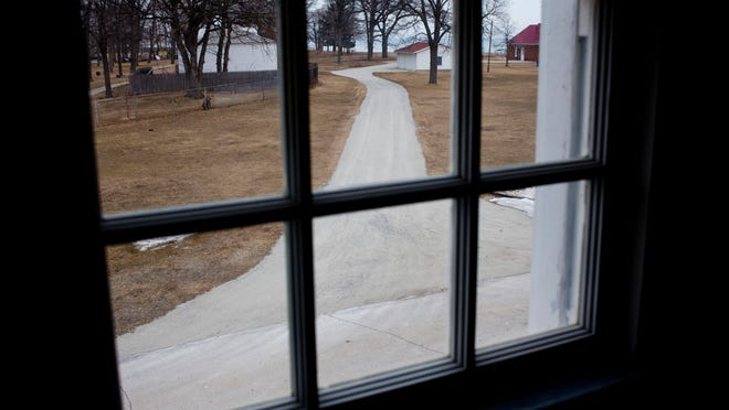 A view through one of 19 new replica windows that have been installed at the gift shop building as part of a restoration effort at the Fort Gratiot Light Station County Park. The 25-year plan to restore the property began in 2011, and the gift shop building will be the first to be completed.