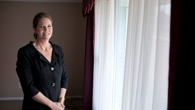 Coldwell Banker real estate agent Cheri Smith pictured at a Connecticut Avenue home in Marysville she recently helped a couple close on. The cost of closing on a home in St. Clair County is about in line with the state average.