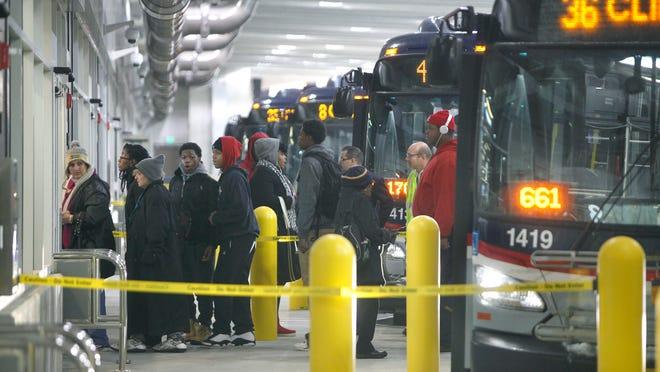 Passengers arrive at the RTS Transit Center.
