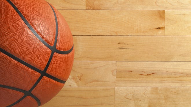 Basketball on wood gym floor viewed from above