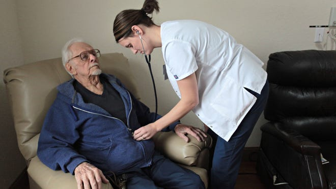 Karie Wilson, LPN, checks Paul Henderson's heart at Maranatha Village on Thursday. Maranatha Village is one of 17 nursing homes in the Springfield-Branson Combined Metropolitan Area to receive the highest possible rating for 2015 from the Centers for Medicare and Medicaid Services. Facilities are rated on a five-star scale — the higher the score the better. The 2015 ratings are being released today.