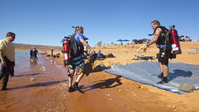 Greg Winkler, from St. George, and Manuel Quintanilla, from Hurricane, cross the finish line at the 2nd annual Ultimate Diver Challenge at Sand Hollow Reservior, Saturday, August 16, 2014.