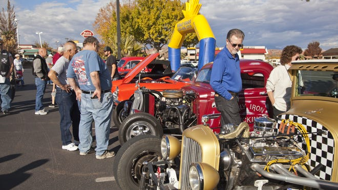 Car enthusiasts gather at last year's annual Car Guys Care show and show fundraiser to benefit the Toys For Tots program.