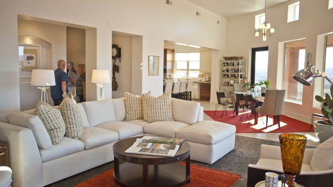 Home 9, The Portrush, in the Parade of Homes is located in Entrada, and features high ceilings and large windows to take in the surrounding red rock cliffs. Tuesday, Feb. 17, 2015.