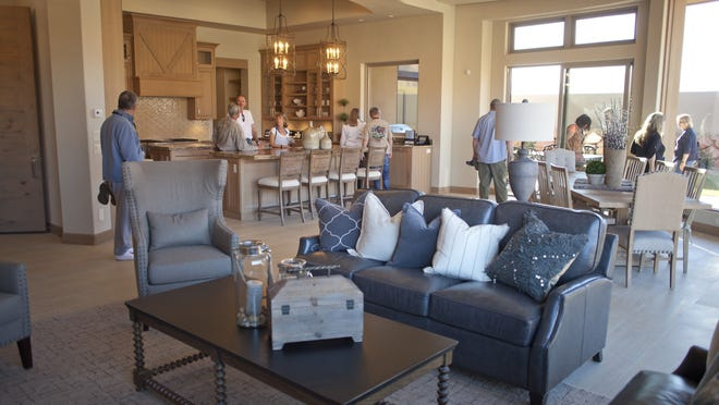 The Palisades Crestview, Home 13 on the Parade of Homes, opens up to the surrounding terrain with plenty of windows, yet emphasizes private, outdoor spaces.