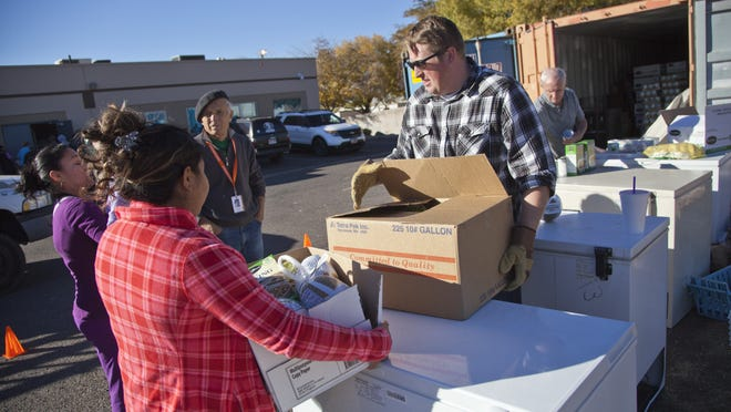 Chris Knowlton helps distribute Thanksgiving food to families in need at SwitchPoint on Nov. 25.