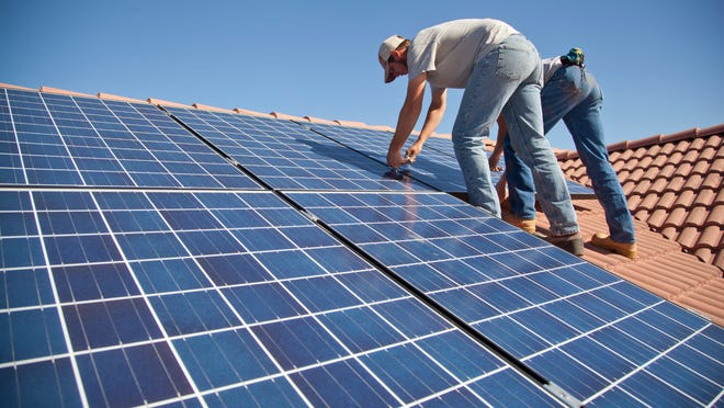 Technicians from Legend Solar install solar panels on a St. George, Utah home in 2015.