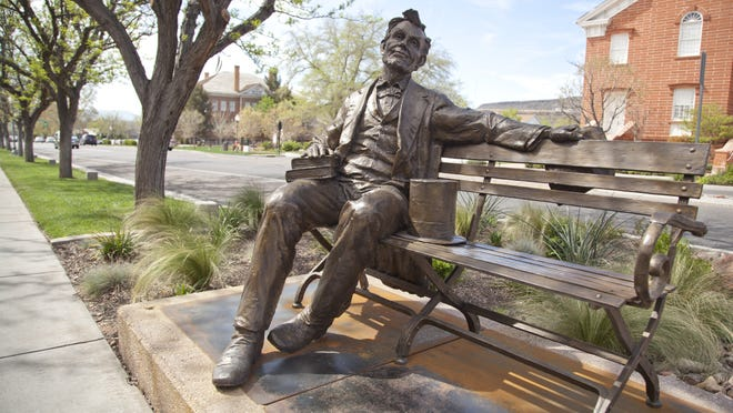 """""""Abraham Lincoln,"""" by artist Gary Lee Price, sits on a sidewalk across from the St. George Tabernacle Tuesday. The piece is one of two dozen outdoor sculptures included in the Art Around the Corner art show. New pieces are slated to rotate in this weekend, with the new show opening on Saturday."""