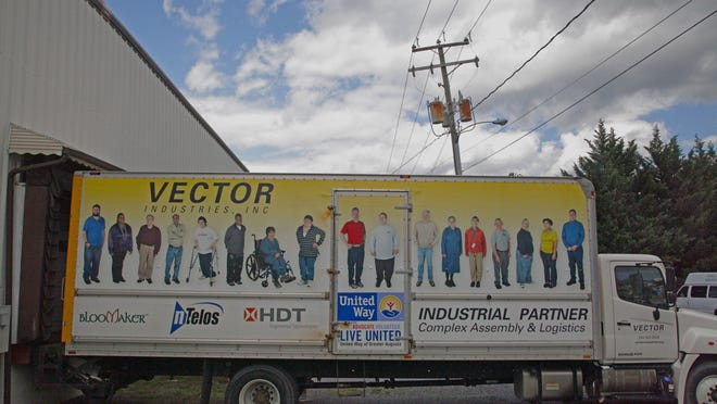A Vector Industries truck at the loading dock bears the portraits of some of its workers. TheWaynesboro company provides assembly and packaging jobs to over 100 adults with wide-ranging disabilities, and will soon move to the Matt Cones building in Waynesboro to expand its operations.