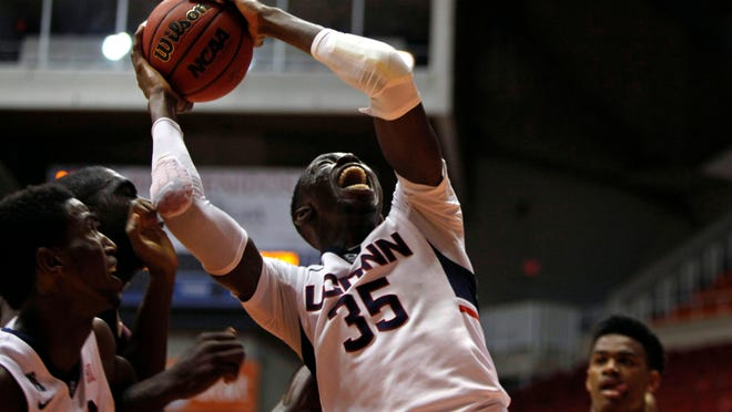 UConn's Amida Brimah grabs a rebound Thursday against Charleston in San Juan, Puerto Rico.