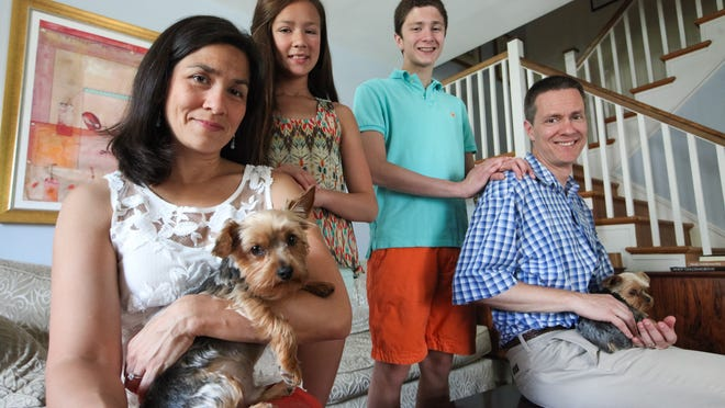 Husband-and-wife authors Marisa de los Santos and David Teague with their children Annabel, 12, and Charles, 15, and dogs Finny (left) and Huxley at their home in North Wilmington.