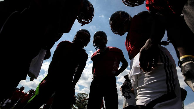 William Penn's offense huddles during an afternoon practice, as football practice opened across the state on Friday.