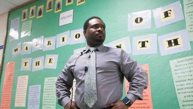 Assistant Principal Terrance D. Newton stands inside H.B. du Pont Middle School. He was a close friend of Jamar Kilgoe, who was shot dead in a community center Monday in New Castle County.