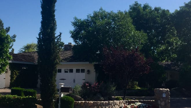 Kurt R. and Nicole Wood bought a 4,354-square-foot house in a cul-de-sac at Arcadia in Phoenix. The 1959 house features four bedrooms, and media, wine and exercise rooms. The property features a pool, outdoor kitchen with bar seating, a gas fire pit, Bocce Ball court and outdoor fireplace. The house was sold by Michelle Reeves, a former manager for sales operations at Hewlett Packard.