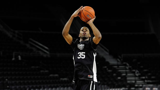 Martez Walker returns after leading Oakland in scoring last season at 17.8 points per game.