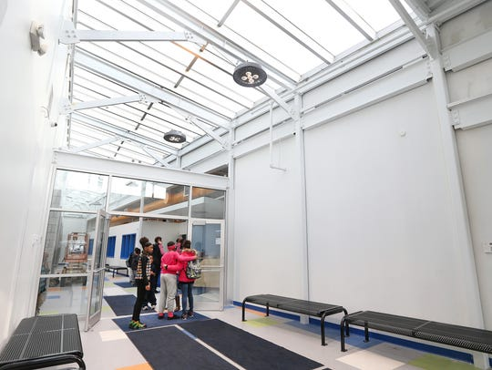 A new front entrance offers  a bright skylight and