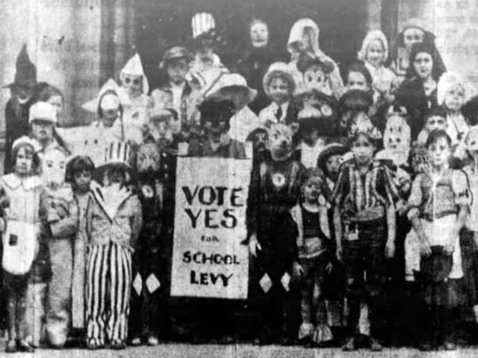Clifton school children in costume campaigning for a school levy.