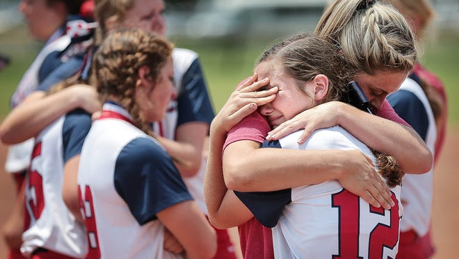 Tipton-Rosemark's Meredith Owen is comforted by assistant coach Mady Gantt after their loss to Silverdale in the finals of the Div II Class A softball finals Friday Morning at Sporing Fling in Murfreesboro.