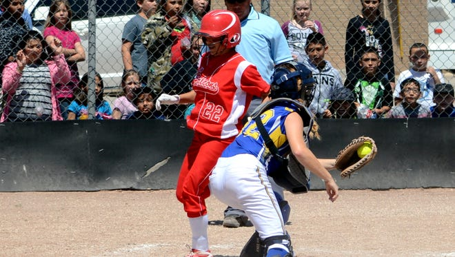 Loving's Alyssa Carrasco steps onto home plate for a 2-run inside-the-park home run in game one Friday against Mesilla Valley Christian.