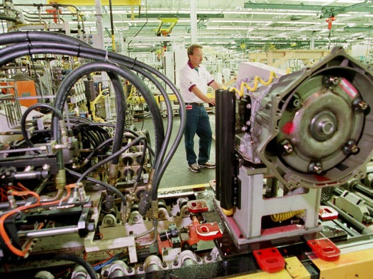 Allison Transmission test mechanic Greg McGuffey is shown working on a fully assembled transmission unit.