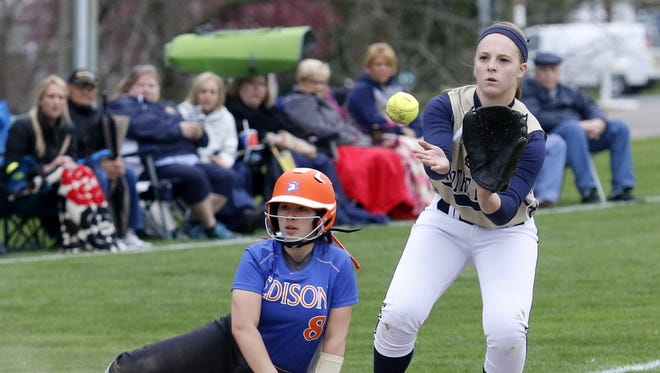 Notre Dame third baseman Mackenzie Maloney waits for the throw after Thomas A. Edison's Mackenzie Bonyak slid into third base April 25 during the Crusaders' 5-4 victory.