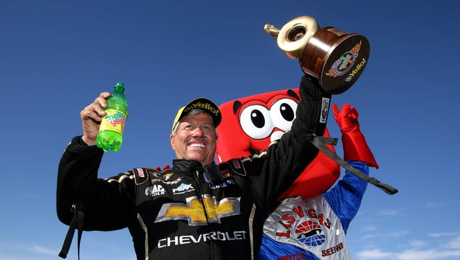 John Force celebrates his 142nd career Funny Car victory.