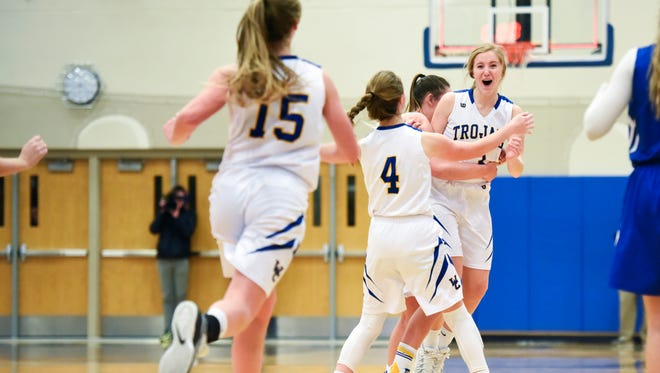 West Central guard Rachel Eickman (3) gets mobbed by teammates after hitting a tying buzzer beater during their high school basketball game on Friday, Jan. 12, 2018. West Central beat St. Thomas More 46-44. It was St. Thomas More's first loss in 48 games.