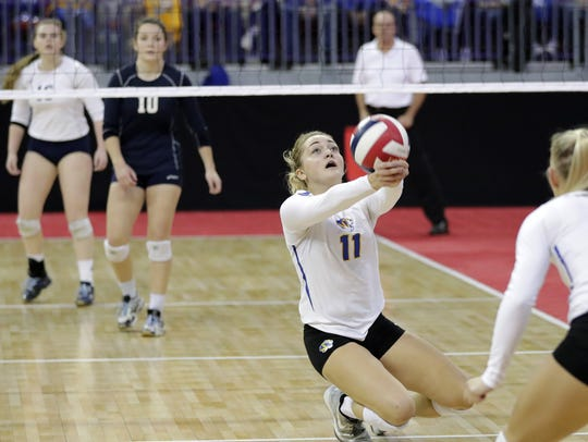Howards Grove's Taylor Bubolz (11) gets a dig against