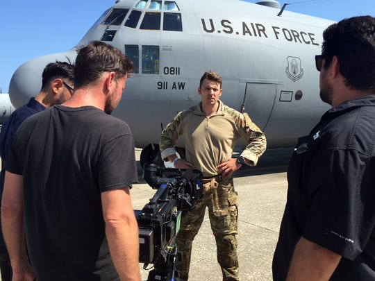 "A Fox TV camera crew shoots footage of Tech. Sgt. Ben Domian, a survival, evasion, resistance, and escape specialist with the 920th Rescue Wing, in front of a HC-130 P/N King June 15, 2016 at Patrick Air Force Base, Fla. The network shot footage of Domian to use for its newest reality show, ""Kicking and Screaming,"" which airs March. 9. Domian is one of 20 contestants on the show."