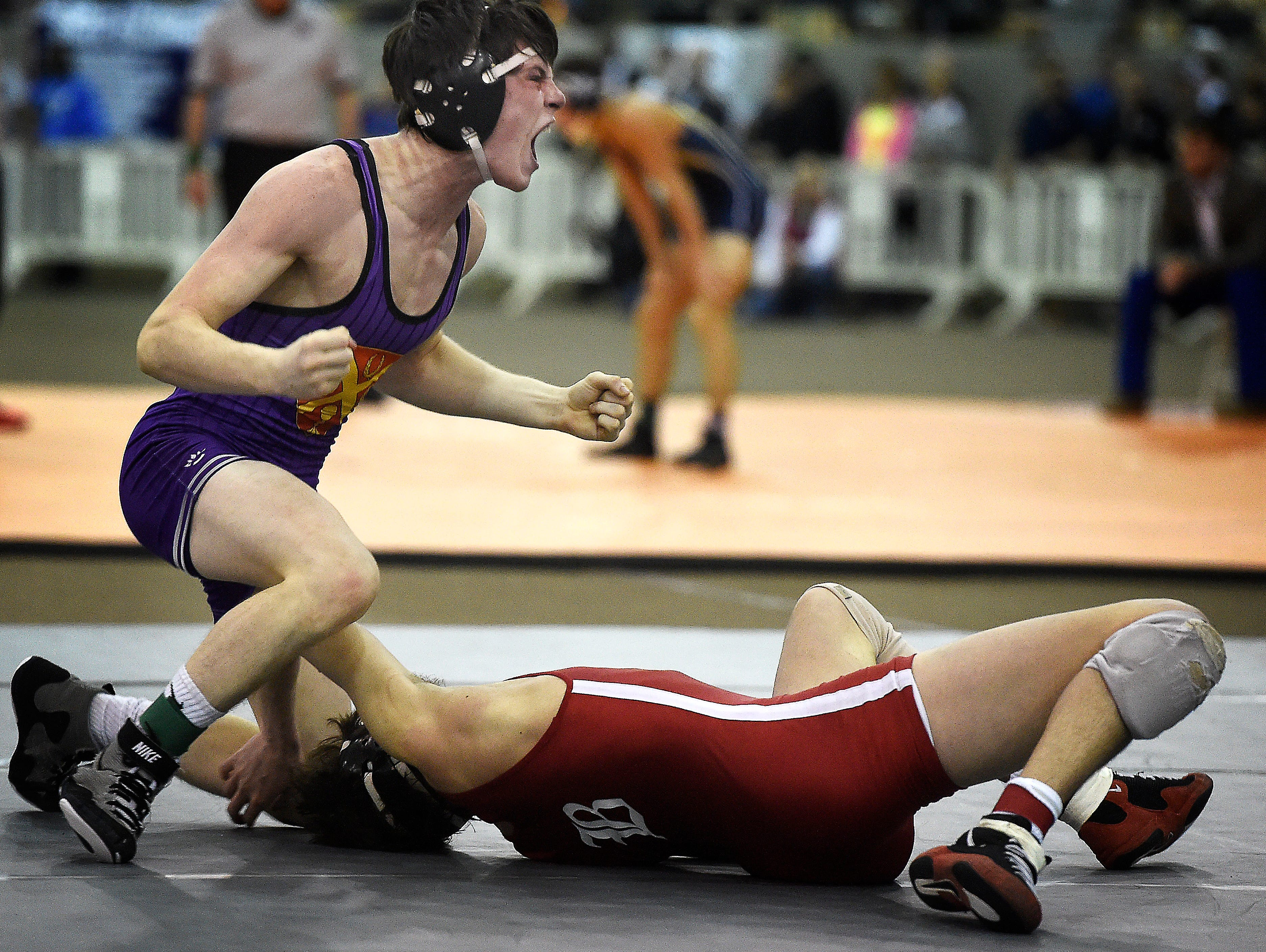 Kirby Simpson (Ryan) celebrates his win over Jack Reynolds (Baylor) in the 132 pounds class at the TSSAA state wrestling championships Saturday Feb. 20, 2016, in Franklin, Tenn.