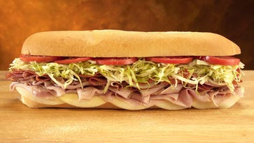 Pictured is Jersey Mike's #13, The Original Italian: provolone, ham, prosciuttini, cappacuolo, salami and pepperoni, served with onions, lettuce, tomatoes, red wine vinegar and olive oil.