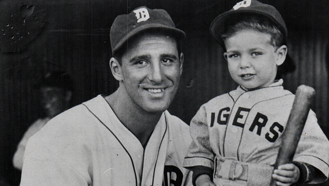 Marshall Loewenstein of Oak Park, Michigan, 4, posing with Detroit Tigers baseball star Hank Greenberg.