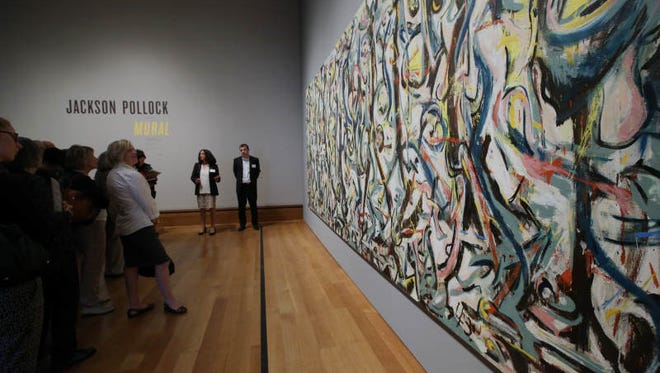 "In this 2014 file photo, members of the media preview Jackson Pollock's ""Mural,"" 1943, at the J. Paul Getty Museum in Los Angeles. Although the most famous single work in the University of Iowa's art collection, the painting has not been in Iowa City since the UI Museum of Art was flooded in 2008. The painting is on tour and won't return to Iowa City until after a new museum building is constructed."
