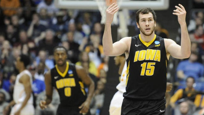 Iowa forward Zach McCabe (15) asks for recognition from the crowd after making a shot against Tennessee during the first half of a first-round game of the NCAA college basketball tournament on Wednesday, March 19, 2014, in Dayton, Ohio.